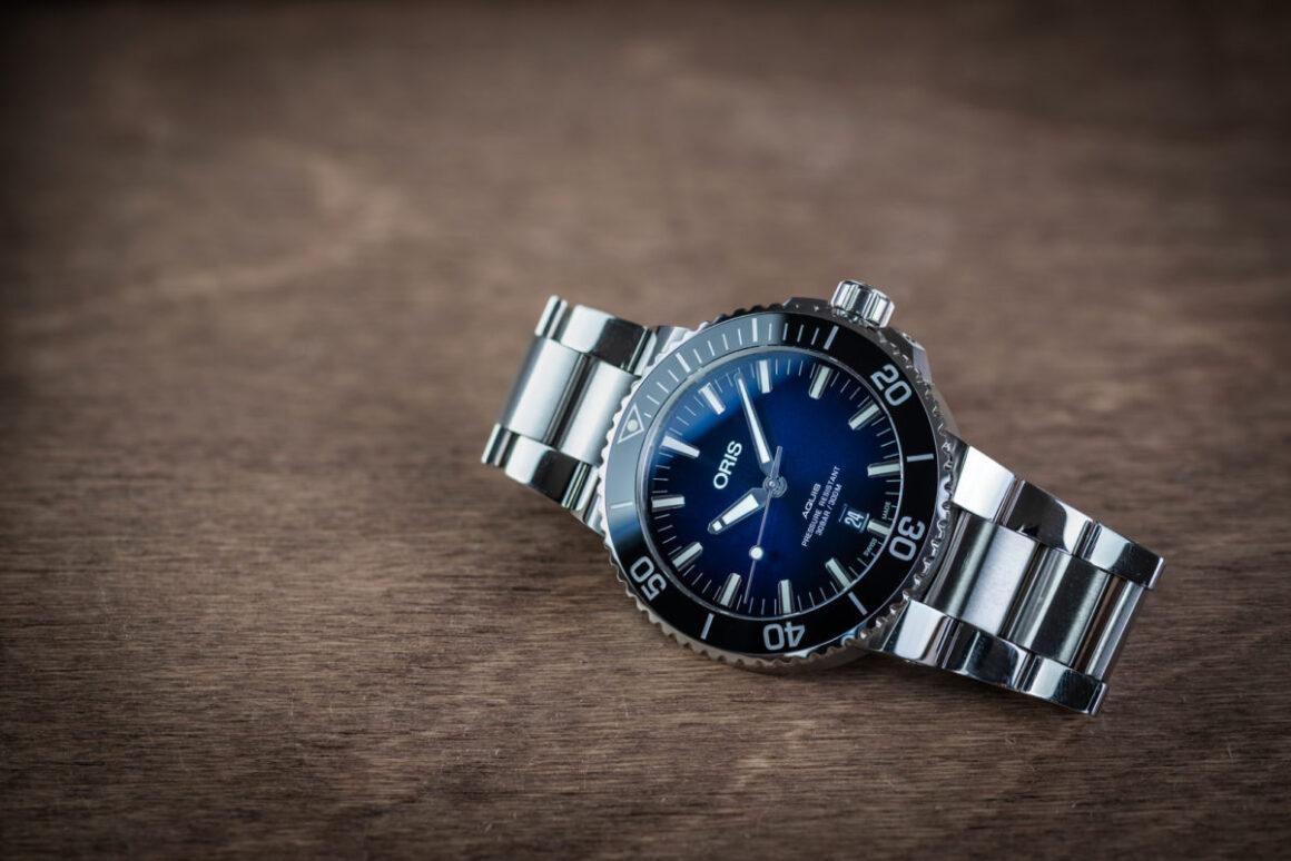 The 43.5mm Oris Aquis with a sunburst blue dial on the bracelet