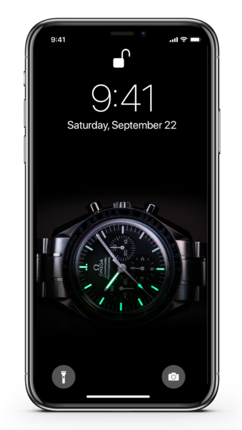 The Omega Speedmaster lume shot displayed on an iPhone Xs