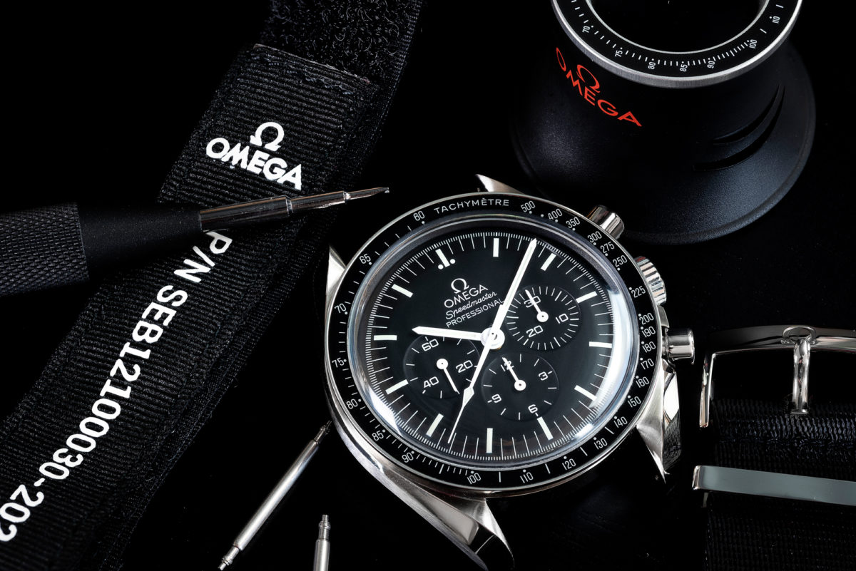 The Omega Speedmaster Professional and some of the items Omega includes in the box